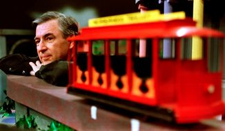 "In this May 27, 1993, photo Fred Rogers pauses during a taping of his show ""Mister Rogers' Neighborhood"" in Pittsburgh. (AP Photo/Gene J. Puskar, File)"