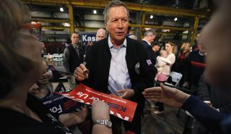 Republican presidential candidate, Ohio Gov. John Kasich works the crowd after a town hall meeting at the River Steel plant, Monday, March 28, 2016, in West Salem, Wis. (AP Photo/Charles Rex Arbogast)