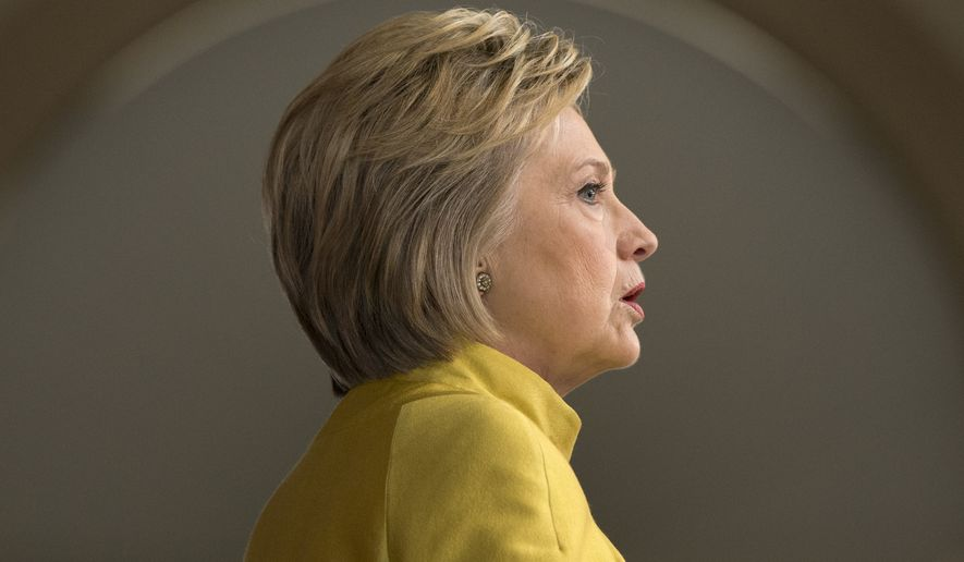 Hillary Clinton said her Supreme Court nominees would have to prove that they would uphold the Roe v. Wade decision establishing a national right to abortion and would have to show that they would overturn the Citizens United decision that established free speech campaign rights for interest groups. (Associated Press)