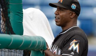 Miami Marlins coach Barry Bonds said he's impressed with Washington Nationals slugger Bryce Harper. (AP Photo/John Raoux)