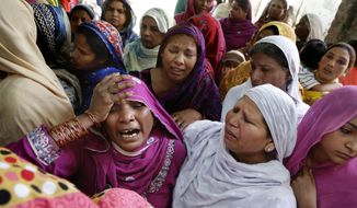 Pakistani Christian women mourn the death of a man killed form a bombing attack, in Lahore, Pakistan, Monday, March 28, 2016. The death toll from a massive suicide bombing targeting Christians gathered on Easter in the eastern Pakistani city of Lahore rose on Monday as the country started observing a three-day mourning period following the attack. (AP Photo/K.M. Chaudary)