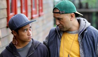 """In this image released by Broad Green Pictures, James Rolleston, left, and Cliff Curtis appear in a scene from,""""The Dark Horse.""""  (Steve King/Broad Green Pictures via AP)"""