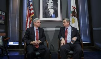 Sen. Mark Kirk, Illinois Republican, meets with Judge Merrick Garland (left), President Obama's choice to replace the late Justice Antonin Scalia on the Supreme Court. (Associated Press)