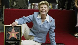 Academy Award winner and television actress Patty Duke is honored with a star on the Hollywood Walk of Fame in the Hollywood section of Los Angeles on Aug. 17, 2004. (Associated Press) **FILE**