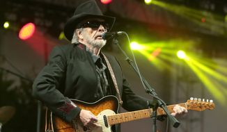 """FILE - In this June 28, 2015 file photo, singer-songwriter Merle Haggard performs at the 2015 Big Barrel Country Music Festival in Dover, Del. Haggard has canceled his April concert dates as he recovers from a recurring bout of double pneumonia. The 78-year-old singer of hits like """"Okie From Muskogee,"""" ''Mama Tried"""" and """"Workin' Man Blues"""" had also cancelled dates in February and March. (Photo by Owen Sweeney/Invision/AP, File)"""