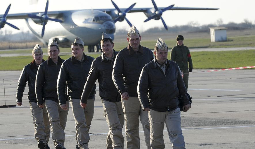 Russian pilots march after returning from Syria at an air base in Primorsko-Akhtarsk, Russia, on March 16. (Associated Press)