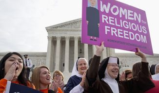 In this March 23, 2016, file photo, nuns and their supporters rally outside the Supreme Court in Washington as the court hears arguments to allow birth control in health care plans in the Zubik vs. Burwell case. (AP Photo/Jacquelyn Martin, File)