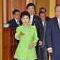 South Korean President Park Geun-hye, left, ushers U.N. Secretary-General Ban Ki-moon, right, at the presidential Blue House during their meeting in Seoul Friday, Aug. 23, 2013. (AP Photo/Jung Yeon-je, Pool)