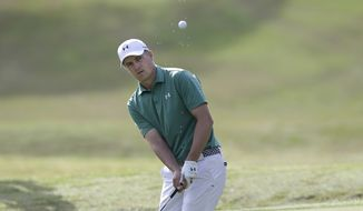 Jordan Spieth hits on the seventh hole during the round of 16 play against Louis Oosthuizen at the Dell Match Play Championship golf tournament at Austin County Club, Saturday, March 26, 2016, in Austin, Texas. (AP Photo/Eric Gay)
