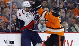 Philadelphia Flyers' Radko Gudas, right, checks Washington Capitals' Alex Ovechkin during the second period of an NHL hockey game, Wednesday, March 30, 2016, in Philadelphia. (AP Photo/Matt Slocum)
