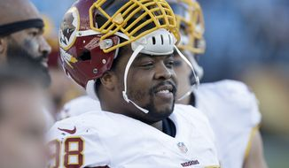 Washington Redskins' Terrance Knighton (98) on the sidelines during the second half of an NFL football game against the Carolina Panthers in Charlotte, N.C., Sunday, Nov. 22, 2015. The Panthers won 44-16. (AP Photo/Bob Leverone)