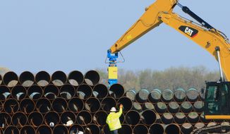 FILE - In this May 9, 2015 file photo, pipes for the proposed Dakota Access oil pipeline, that would stretch from the Bakken oil fields in North Dakota to Illinois, are stacked at a staging area in Worthing, S.D. On Friday, April 1, 2016, members of the Standing Rock Sioux and other tribes plan a protest ride against the proposed pipeline Friday, April 1, 2016, across the Standing Rock Reservation, which straddles the North Dakota-South Dakota border. (AP Photo/Nati Harnik, File)