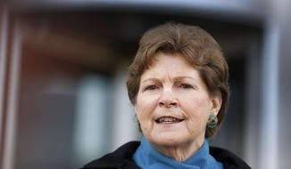 Democratic U.S. Sen. Jeanne Shaheen speaks to reporters outside the federal courthouse Wednesday March 30, 2016 in Concord, N.H., about the need to hold hearings on President Barack Obama's Supreme Court nominee Merrick Garland. (AP Photo/Jim Cole)