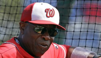 Washington Nationals manager Dusty Baker watches batting practice before a spring training baseball game against the New York Yankees, Wednesday, March 23, 2016, in Viera, Fla. (AP Photo/John Raoux)