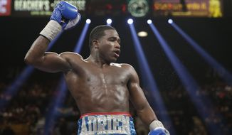 Adrien Broner is seen during his WBA super lightweight title boxing fight against Carlos Molina Saturday, May 3, 2014, in Las Vegas. (AP Photo/Isaac Brekken)