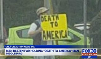 """A Florida man protesting President Obama's policies with a """"Death to America"""" sign Tuesday afternoon was physically attacked by a man and a woman, police said. (WJAX)"""