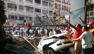 Locals and rescue workers clear the rubbles of a partially collapsed overpass in Kolkata, Thursday, March 31, 2016. At least dozens have been injured and few were killed when a portion of an overpass under construction collapses in a congested area in the eastern Indian city of Kolkata. (AP Photo/Bikas Das)