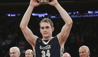 George Washington's Tyler Cavanaugh poses for photographs while holding the Most Outstanding Player trophy after the team's NCAA college basketball game against Valparaiso in the final of the NIT on Thursday, March 31, 2016, in New York. George Washington won 76-60. (AP Photo/Frank Franklin II) **FILE**