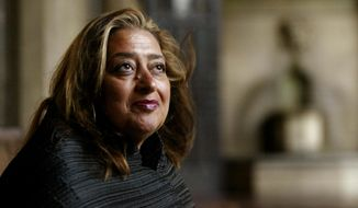 In this March 21, 2004, file picture, Iraqi-British architect Zaha Hadid poses in West Hollywood, Calif. Hadid, whose modernist, futuristic designs included the swooping aquatic center for the 2012 London Olympics, has died aged 65, Thursday, March 31, 2016. (AP Photo/Kevork Djansezian, File)