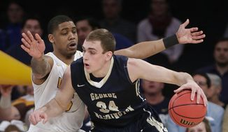Valparaiso's Darien Walker (5) defends George Washington's Tyler Cavanaugh (34) during the first half of an NCAA college basketball game in the final of the NIT on Thursday, March 31, 2016, in New York. (AP Photo/Frank Franklin II) **FILE**