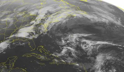 This NOAA satellite image taken Friday, April 1, 2016 at 12:45 AM EDT shows a cold front extending from the Great Lakes southward into the Gulf of Mexico. Severe storms will sweep across the Southeast along this cold front. Some tornadoes are possible. (NOAA/Weather Underground via AP)