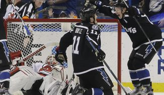 Tampa Bay Lightning center Brian Boyle (11) celebrates his goal against the New Jersey Devils with left wing Ondrej Palat (18), of the Czech Republic, during the third period of an NHL hockey game Saturday, April 2, 2016, in Tampa, Fla. (AP Photo/Chris O'Meara)