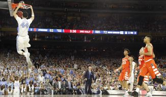 North Carolina forward Justin Jackson (44) dunks the ball on Syracuse during the second half of the NCAA Final Four tournament college basketball semifinal game Saturday, April 2, 2016, in Houston. (AP Photo/David J. Phillip)