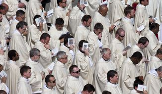 Priests attend a Mass celebrated by Pope Francis for the the Holy Year of Mercy, in St. Peter's Square at the Vatican, Sunday, April 3, 2016. (AP Photo/Alessandra Tarantino)