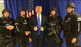 Republican front-runner Donald Trump stands with law enforcement officers during a campaign stop in West Allis, Wisconsin on Monday. (Donald J. Trump for President, Inc.)
