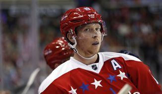 Washington Capitals center Nicklas Backstrom (19), Sweden, pauses in the second period of an NHL hockey game against the St. Louis Blues, Saturday, March 26, 2016, in Washington. (AP Photo/Alex Brandon)