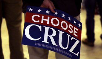 A supporter holds a sign as he waits for Republican presidential candidate, Sen. Ted Cruz's campaign stop at Waukesha County Exposition Center, Monday, April 4, 2016, in Waukesha, Wis. (AP Photo/Nam Y. Huh)