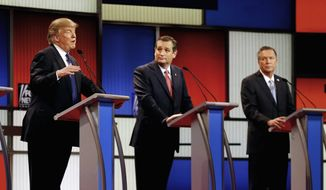 FILE- In this March 3, 2016 file photo, Republican presidential candidates, businessman Donald Trump, Sen. Ted Cruz, R-Texas, and Ohio Gov. John Kasich appear during a Republican presidential primary debate at the Fox Theatre in Detroit. Michigan Republicans meet Saturday, April 9, in Lansing for their annual convention with one of the main agenda items the choosing of delegates to the party's presidential convention in July in Cleveland. (AP Photo/Paul Sancya) **FILE**