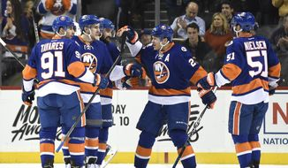 New York Islanders defenseman Ryan Pulock (6), second from left, celebrates his goal with center John Tavares (91), defenseman Nick Leddy (2), right wing Kyle Okposo (21) and center Frans Nielsen (51) in the first period of an NHL hockey game against the Tampa Bay Lightning, Monday, April 4, 2016, in New York. (AP Photo/Kathy Kmonicek)