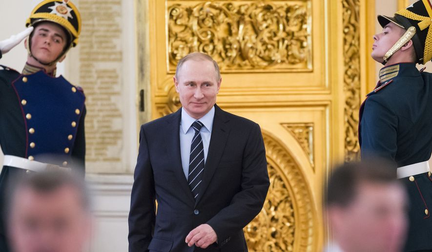 Russian President Vladimir Putin, center, arrives to hold a meeting of a committee on preparations for upcoming Victory Day in WWII, in Moscow's Kremlin, Russia, on Tuesday, April 5, 2016. Russia celebrates Victory Day on May 9. (AP Photo/Alexander Zemlianichenko, pool)