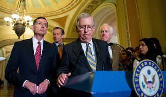 Senate Majority Leader Mitch McConnell of Ky., center, accompanied by, from left, Sen. John Barrasso, R-Wyo., Sen. John Thune, R-S.D., and Senate Majority Whip John Cornyn of Texas, pauses during a news conference on Capitol Hill in Washington, Tuesday, April 5, 2016, following a policy luncheon. McConnell took questions on the potential for hearings on Merrick Garland as President Barack Obama's nominee to the Supreme Court, his relationship to Republican presidential candidates and other topics. (AP Photo/Andrew Harnik)