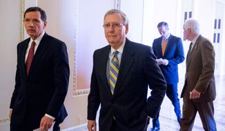 Senate Majority Leader Mitch McConnell of Ky., second from left, accompanied by Sen. John Barrasso, R-Wyo., left, Sen. John Thune, R-S.D., second from right, and Majority Whip John Cornyn of Texas, right, walk to news conference on Capitol Hill in Washington, Tuesday, April 5, 2016, following a policy luncheon. McConnell took questions on the potential for hearings on Merrick Garland as President Barack Obama's nominee to the Supreme Court, his relationship to Republican presidential candidates and other topics. (AP Photo/Andrew Harnik)