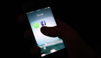 This Feb. 19, 2014, file photo shows the Facebook app icon on an iPhone in New York. (AP Photo/Karly Domb Sadof, File)