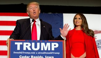 Donald Trump, seen with wife Melania during a campaign stop in Iowa. (Associated Press) ** FILE **