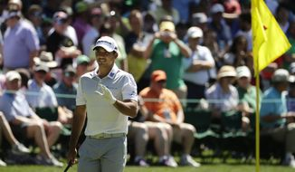 Jason Day, of Australia, waves to spectators on the 16th green during a practice round for the Masters golf tournament, Monday, April 4, 2016, in Augusta, Ga. (AP Photo/Charlie Riedel)