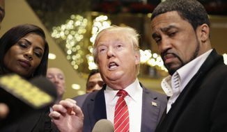 FILE - In this Nov. 30, 2015 file photo, Republican presidential candidate Donald Trump, center, talks with reporters while surrounded by a group of African-American religious leaders in New York, following a meeting with a coalition of 100 African-American evangelical pastors and religious leaders in a private meeting at Trump Tower. Hometown candidates Hillary Clinton and Trump have long eyed New York as a bulwark against their opposition. Now both need the state, that votes in the presidential primary on April 19, 2016, to provide a bounce-back victory after some disheartening defeats. (AP Photo/Seth Wenig, File)