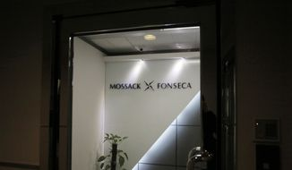 The entrance of the regional head office of Panama-based law firm Mossack Fonseca, one of the world's biggest creators of shell companies, in Hong Kong,  America's openness to foreign tax evaders is coming under new scrutiny after the leak this week of 11.5 million confidential documents from the Panamanian law firm. The Panama Papers show how some of the world's richest people hide assets in shell companies to avoid paying taxes. (AP Photo/Vincent Yu)
