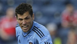 Orlando City SC goalie Tally Hall points as he yells to teammates during the first half of an MLS soccer game against the Chicago Fire on Saturday, June 6, 2015, in Bridgeview, Ill. (AP Photo/Nam Y. Huh)