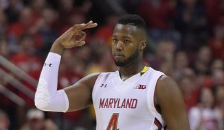 Maryland forward Robert Carter (4) gestures after he hit a basket during the second half of an NCAA college basketball game against the Ohio State, Saturday, Jan. 16, 2016, in College Park, Md. Maryland won 100-65. (AP Photo/Nick Wass)