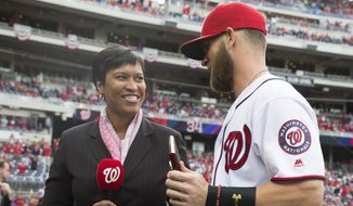 """District of Columbia mayor Muriel Bowser, left, presents Washington Nationals Bryce Harper with a """"key to the city"""" before a Major League Baseball game against the Miami Marlins, at Nationals Park, on Thursday, April 7, 2016, in Washington. (AP Photo/Evan Vucci)"""