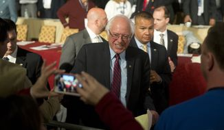 Democratic presidential candidate, Sen. Bernie Sanders, I-Vt. meets with attendees during a campaign stop, Thursday, April 7, 2016, at the Pennsylvania AFL-CIO Convention in Philadelphia. (AP Photo/Matt Rourke)