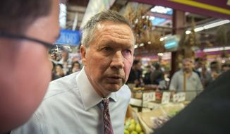 Republican presidential candidate Ohio Gov. John Kasich visits Mike's Deli during a campaign stop, Thursday, April 7, 2016 in New York. (AP Photo/Bryan R. Smith)