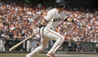 San Francisco Giants' Joe Panik hits an RBI-triple off Los Angeles Dodgers starting pitcher Alex Wood in the fifth inning of their baseball game Thursday, April 7, 2016, in San Francisco. (AP Photo/Eric Risberg)