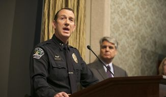 APD Assistant Chief Troy Gay, left, speaks as University of Texas President Gregory L. Fenves, right, listens during a news conference about the death of student Haruka Weiser on Thursday, April 7, 2016, in Austin, Texas. The first-year dance student was the victim of a homicide and police are searching for a man seen near the heart of campus, where her body was found. (Deborah Cannon/Austin American-Statesman via AP)