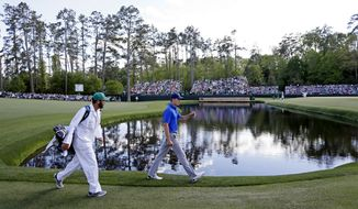 Jordan Spieth walks along the 15th fairway during the second round of the Masters golf tournament Friday, April 8, 2016, in Augusta, Ga. (AP Photo/Matt Slocum)