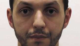 This is an undated photograph provided by Belgian Federal Police shows Mohamed Abrini. Belgian authorities say several arrests have been made in relation to the Brussels attacks. (Belgian Federal Police via AP) ** FILE **